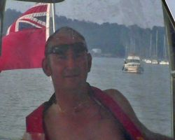 David at the helm on the Medway