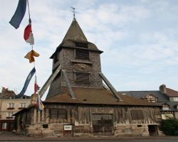 The detached church bell tower was rebuilt by local boat builders after the 100 years war