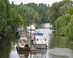 The leafy surroundings of the Carr� boatyard at Poissy