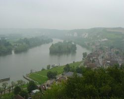 A misty view across the Seine valley; the three boats are in the middle of the picture on the green pontoon, with the harbour entrance to the left