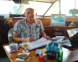 Me log-keeping and planning our 35 voyages!