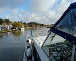 Approaching Reedham Swing bridge in the sun