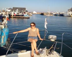 Kathleen on board Lady Martina in fine sunny weather in St Vaast la Hougue