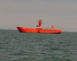 Passing Sunk Inner Lightship cruising out to sea