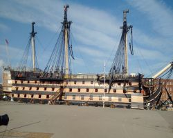 Kathleen dwarfed by the HMS Victory at the Historic Dockyard Portsmouth