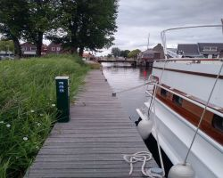 Heeg Alongside Mooring By Lions statue and Visitors Mooring Boxes