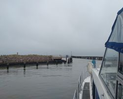 Leaving Southwold by the harbour piers